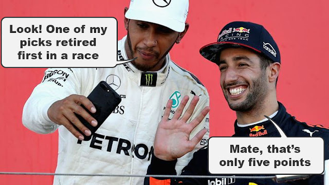 """Lewis Hamilton showing Daniel Ricciardo his phone. He says, """"Look! One of my picks retired first in a race."""" A beaming Ricciardo replies, """"Mate, that's only five points."""""""