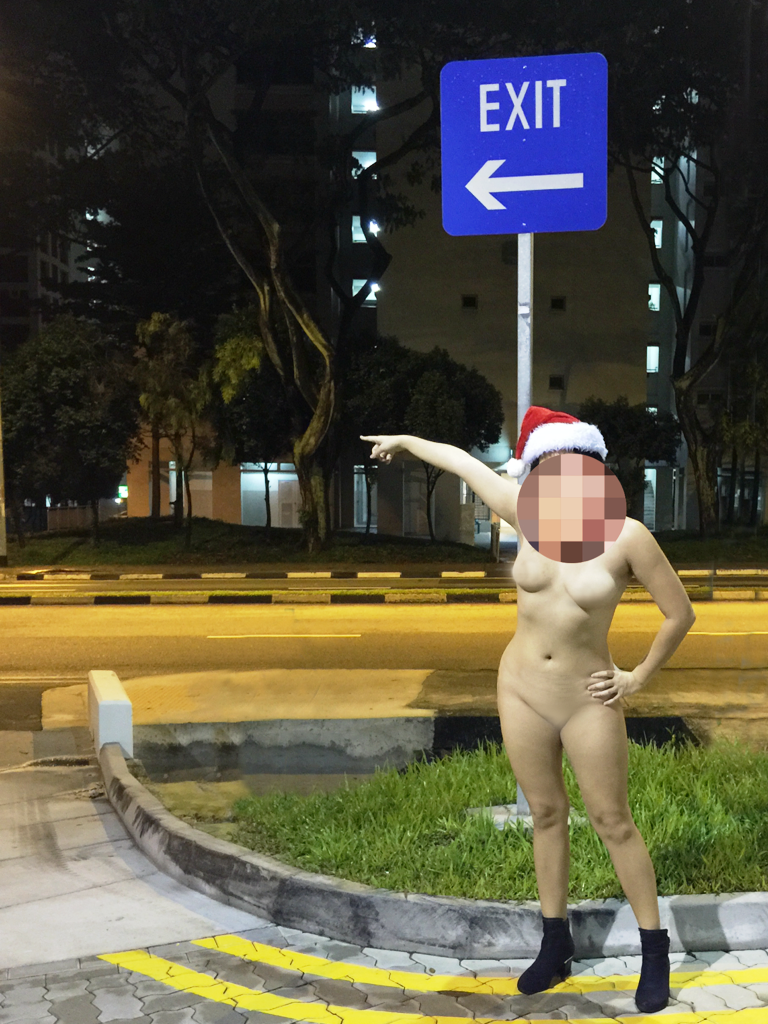 Girl poses nude in a public location