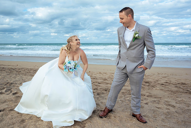 Bride and Groom laughing on the beach