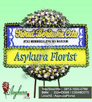 Toko Karangan Bunga Bekasi menerima pesanan karangan bunga papan turut berduka cita.