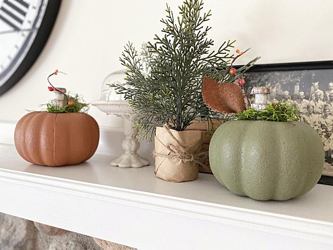 pumpkins on the mantel