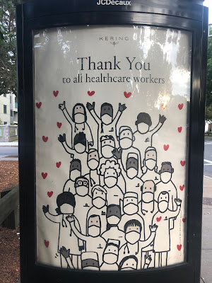 """Cartoon poster of healcare workers with masks. Above it reads, """"Thank You to all healthcare workers"""""""