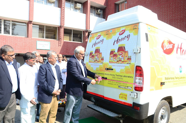 Dabur India Ltd CEO Mr. Sunil Duggal flags off Dabur's mobile Honey Testing Van.