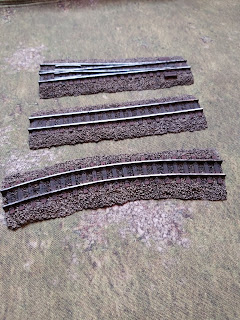 The railway tracks by Ironclad Miniatures fully painted