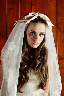 1960's style bride with bouffant hair and big veil with satin bow and sixties inspired makeup