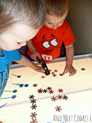 J and K exploring snowflakes on the light table from And Next Comes L