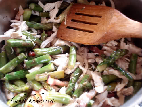 pasta, asparagus, pancetta, chicken chunks and sauce.