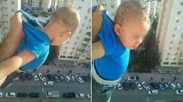 «1 000 лайков или я его отпущу!» Алжирец поделился шокирующим фото ребенка за окном 15-го этажа