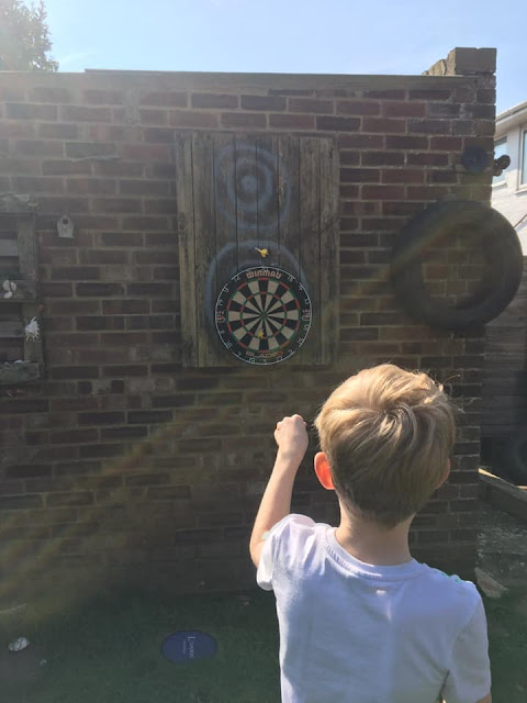 Using a dart board to show answers to maths problems