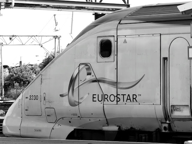 Close up black and white photo of Eurostar train 3230 at Ashford International Station in 2013
