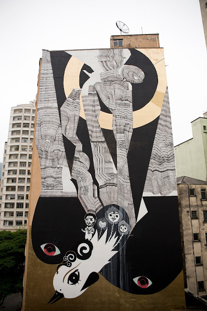 As part of the O.Bra Festival which took place a few days ago on the streets of Sao Paulo, 2501 and Speto were invited to create a large mural featuring each artist's style and imagery.