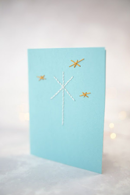 holiday card with four hand-stitched stars
