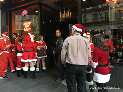 Santacon 2017 participants lined up at Sam's Cable Car Lounge in San Francisco
