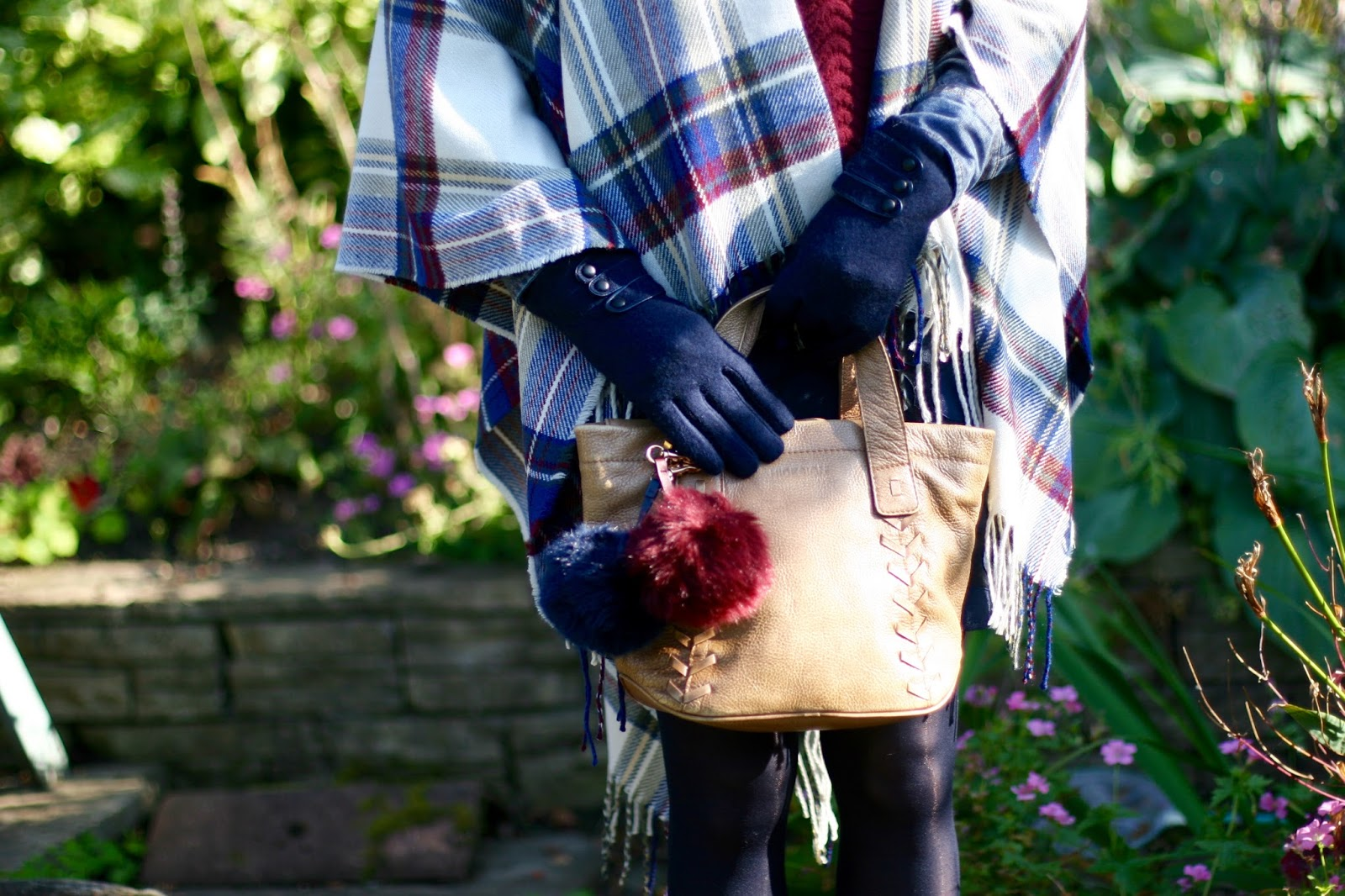 furry pompoms and a plaid cape.