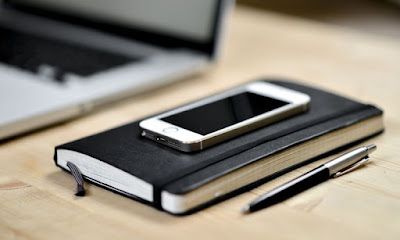 Note book, Pen and smartphone to contact