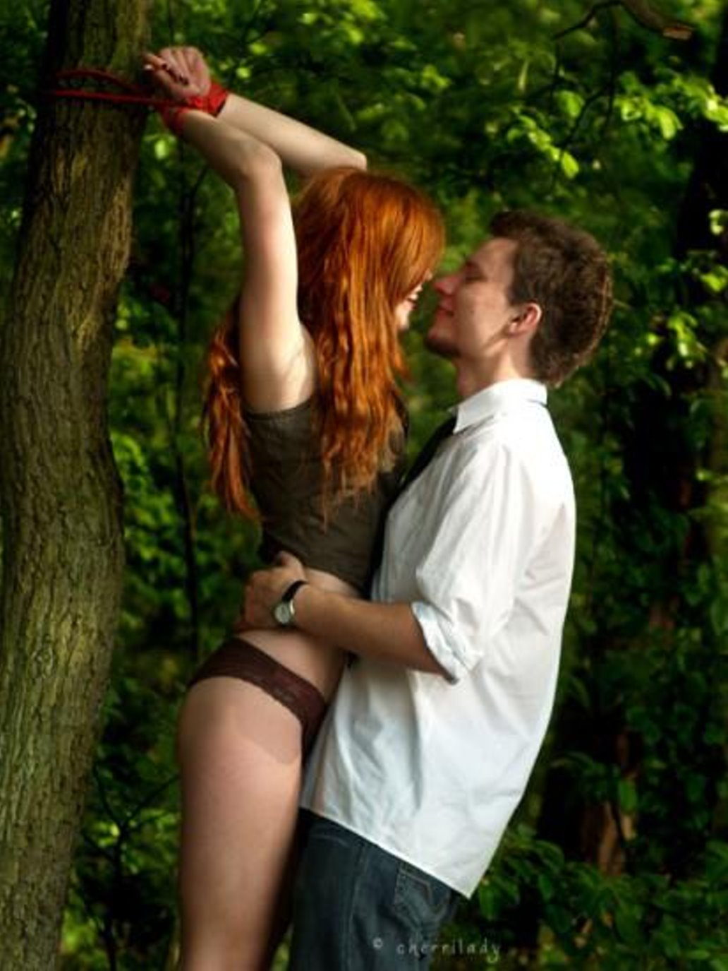 hot naked babe tied to tree