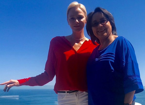 Princess Charlene met with Cape Town Mayor Patricia de Lille. Princess Charlene of Monaco Foundation. Princess Charlene wore red blouse