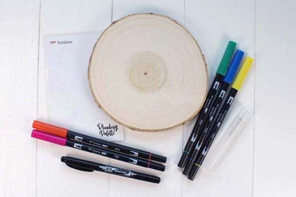 Make a quick 5 minute craft with a wood slice, tombow dual brush pens, spray bottle and blending palette.