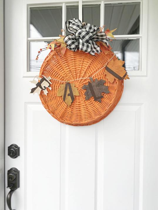 front door with fall basket wreath
