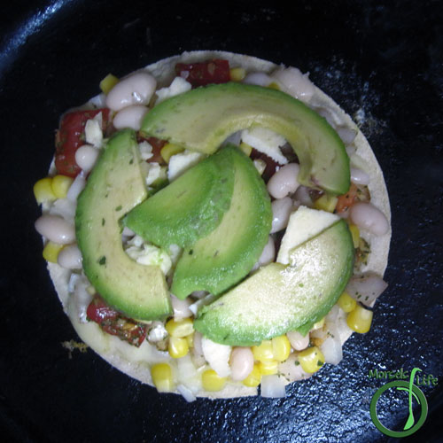 Morsels of Life - Avocado Bean Quesadillas Step 3 - Place 2 heaping tablespoons each of the pico, beans, and corn onto tortillas. Top with approximately 1/2 ounces cheese and avocado slices. Place other tortilla on top, and flip to brown other side.