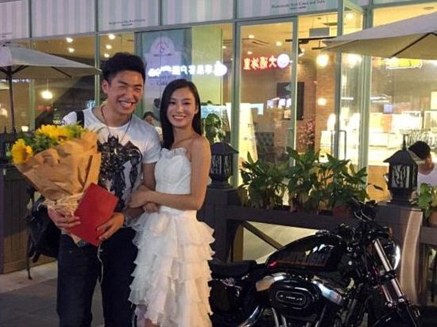 MUST SEE: Woman Proposes To Her Boyfriend Using Harley Bike And Property Deed!