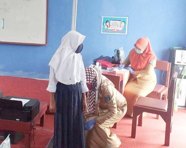 Puskesmas Pedamaran Gelar Penjaringan Kesehatan Anak Sekolah di SMPN 1 Pedamaran.