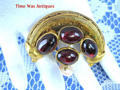 https://timewasantiques.net/products/etruscan-revival-brooch-22kt-gold-genuine-garnets-pearls-1860s-pin-han