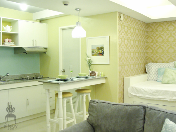 yellow green chic studio unit with small kitchen