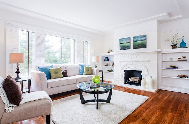 white feng shui living room with fireplace