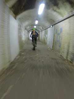 Mountain bike cycling, through a tunnel