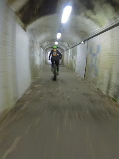 Mountain bike cycling, through a tunnel