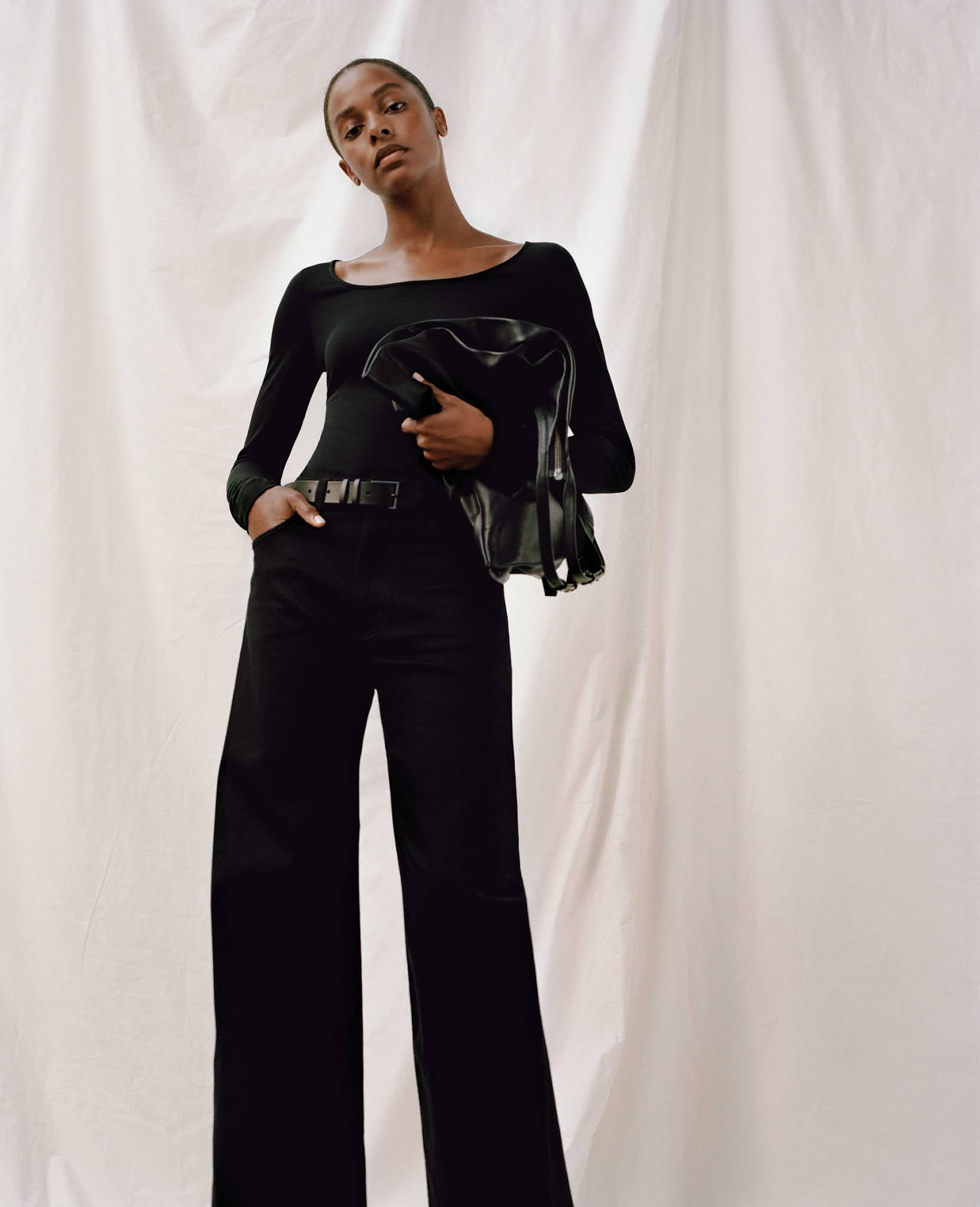 5 Minimalist Fall Outfit Ideas — Capsule Wardrobe with black boatneck top and wide-leg jeans