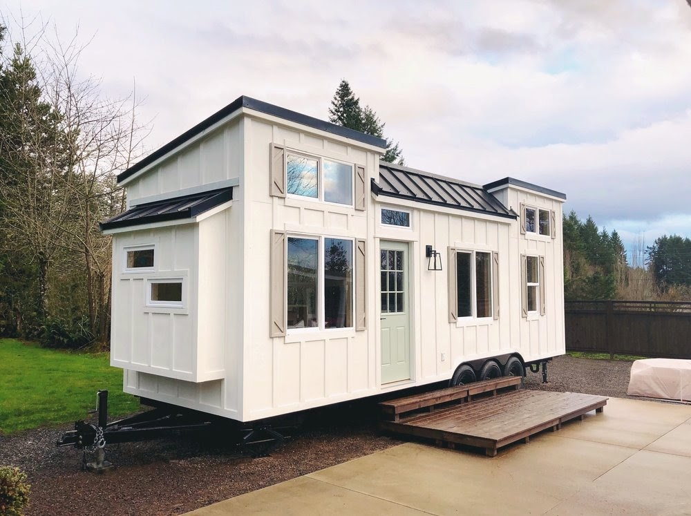 13-External-View-Handcrafted-Movement-Architecture-Tiny-House-on-Wheels-with-plenty-of-Windows-www-designstack-co