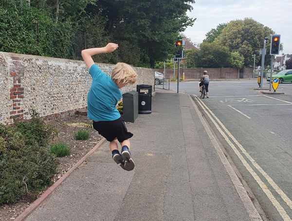 My 9-year-old jumping for joy on the way to school