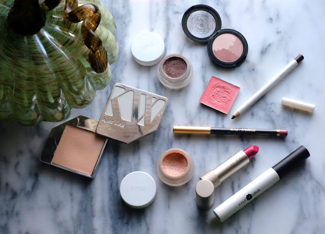 What's in my Fall Makeup Bag, featuring Kjaer Weis Cream Foundation; RMS Beauty Contour Bronze; RMS Beauty's Master Mixer; Kjaer Weis Cream Blush; FitGlow Beauty Mineral Eye Trio in Sunglow; W3ll People Hypnotist Eyepencil in Brown; Lily Lolo's Vegan Mascara; and Ilia Beauty's Tinted Lip Conditioner in Pink Moon.