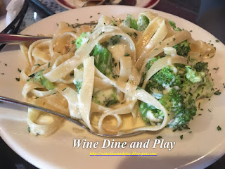 A simple dish of early bird fettuccini alfredo with broccoli at the Gigi's restaurant in St Pete Beach, Florida
