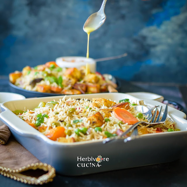 Saffron pouring into paneer vegetable biryani