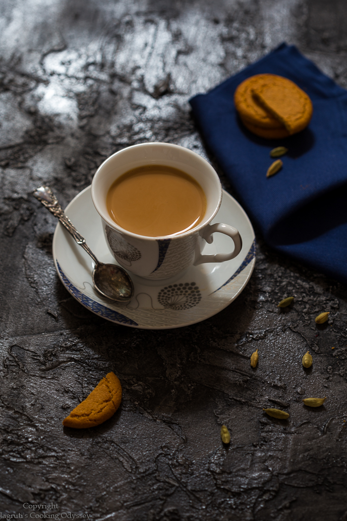 cardamom chai served with ginger nut cookies