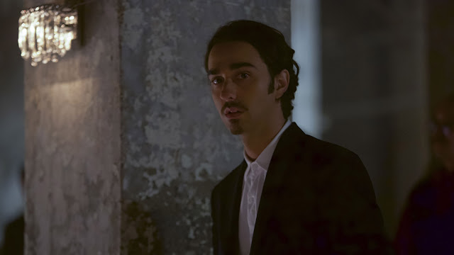 alex wolff in a suit in pig