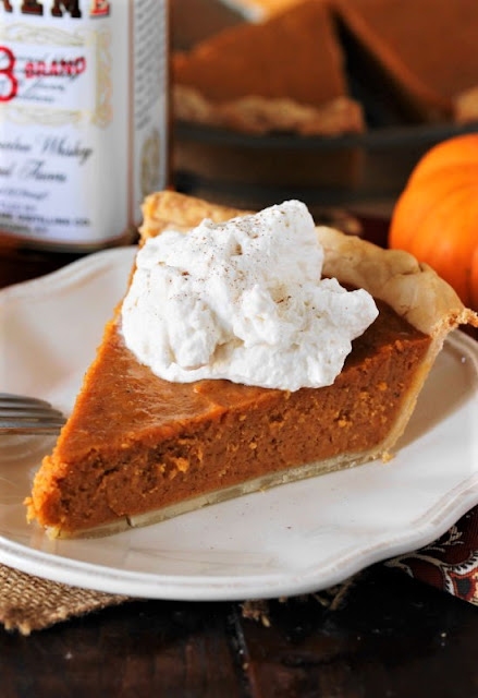 Bourbon Whipped Cream On Top of Pumpkin Pie Image