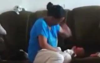 Mãe é presa após ser filmada agredindo bebê por causa de choro