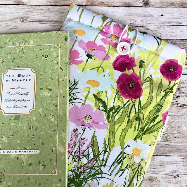 Pretty Watercolor Wildflowers padded book sleeve will help keep your book safe when you are on the go!