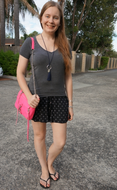 monochromatic grey tee printed shorts outfit with neon pink mini mac bag | away from blue