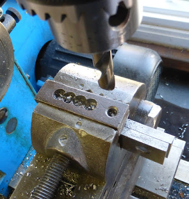 drilling holes for slot in strap clamp