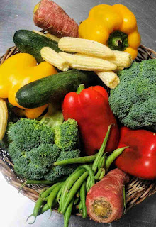 Exotic vegetables, brocoli, babycorn, red, yellow bell pepper, french beans, carrot