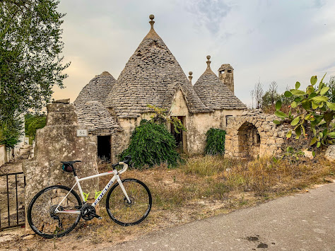 cycling atria valley carbon road bike rental in locorotondo cisternino bicycle shop trulli buildings houses