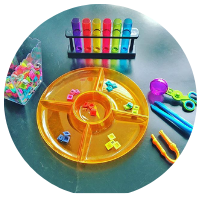 colour sorting tuff tray with rainbow test tubes and coloured letters to sort