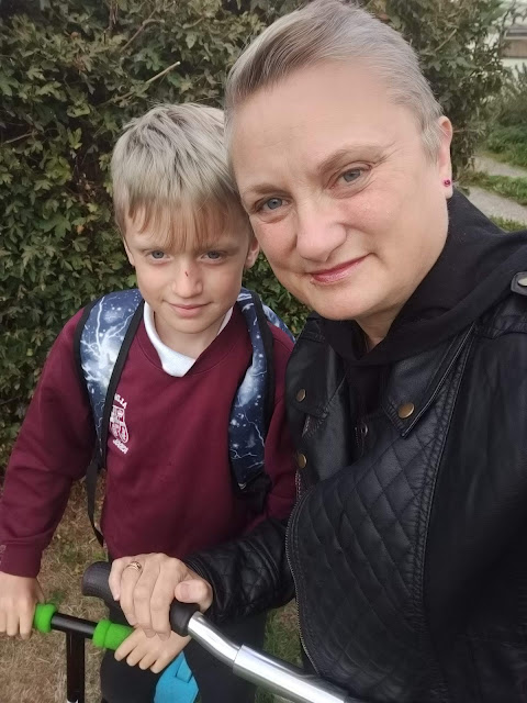 madmumof7 and son scooting to school