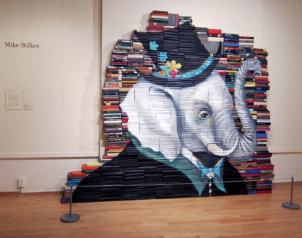 05-Mike-Stilkey-Books-used-as-Canvasses-for-Paintings-www-designstack-co
