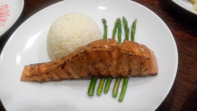 Sweet and Spicy Grilled Salmon Php 610 Grilled Salmon glazed with sweet and spicy mayo, served with rice pilaf and asparagus.
